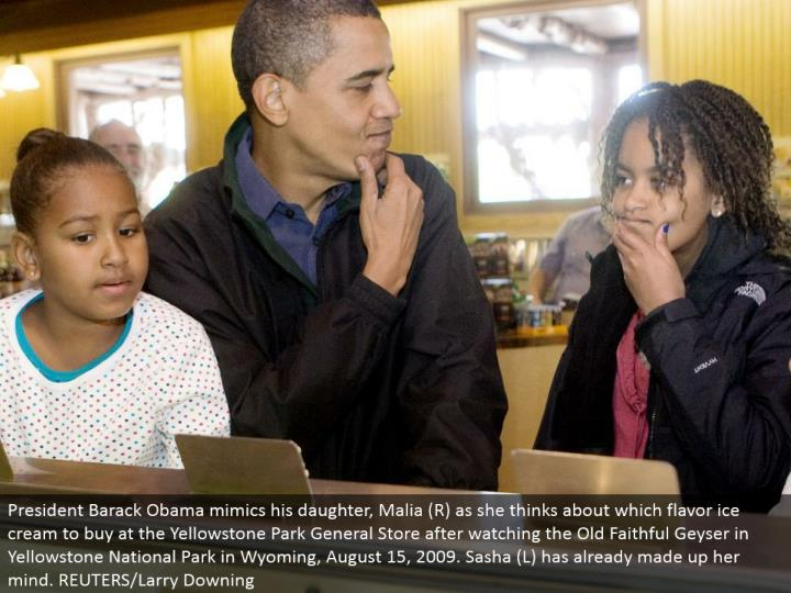President Barack Obama imitates his little girl, Malia (R) as she ponders which flavor frozen yogurt to purchase at the Yellowstone Park General Store in the wake of viewing the Old Faithful Geyser in Yellowstone National Park in Wyoming, August 15, 2009. Sasha (L) has effectively decided. REUTERS/Larry Downing