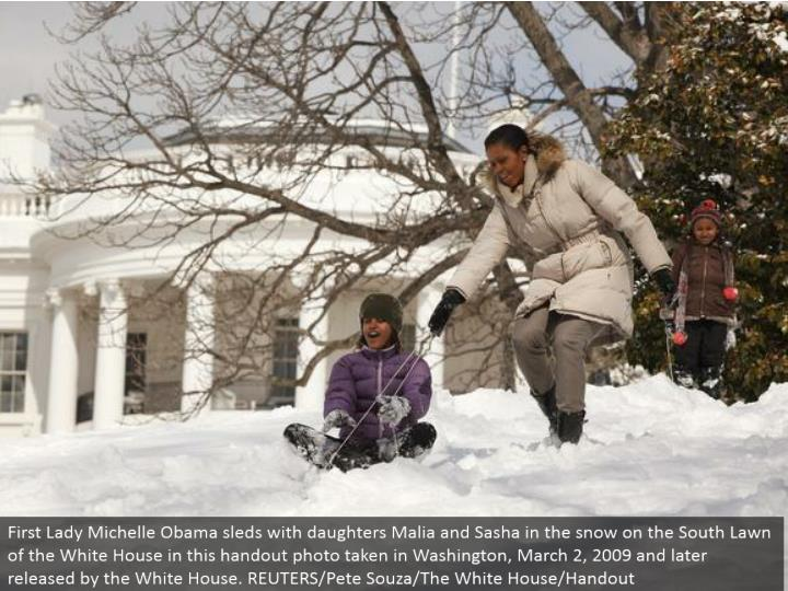 First Lady Michelle Obama sleds with little girls Malia and Sasha in the snow on the South Lawn of the White House in this freebee photograph taken in Washington, March 2, 2009 and later discharged by the White House. REUTERS/Pete Souza/The White House/Handout