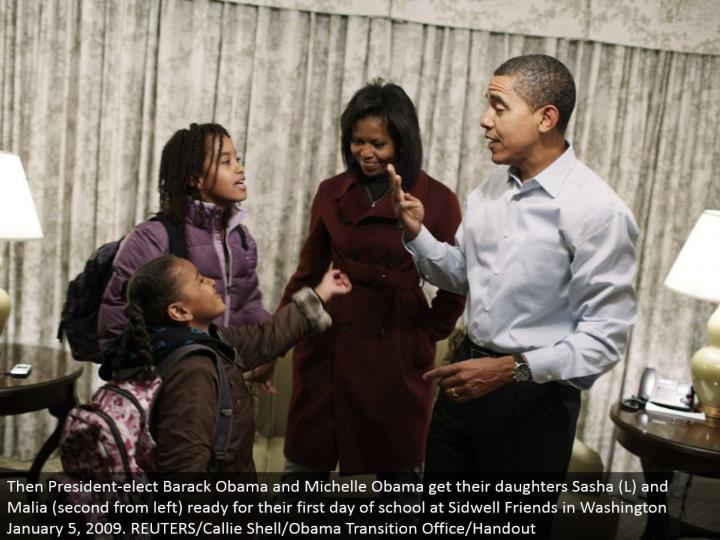 Then President-choose Barack Obama and Michelle Obama get their little girls Sasha (L) and Malia (second from left) prepared for their first day of school at Sidwell Friends in Washington January 5, 2009. REUTERS/Callie Shell/Obama Transition Office/Handout