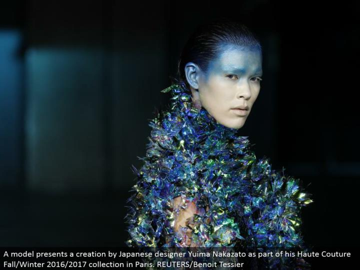 A model shows a creation by Japanese originator Yuima Nakazato as a component of his Haute Couture Fall/Winter 2016/2017 accumulation in Paris. REUTERS/Benoit Tessier