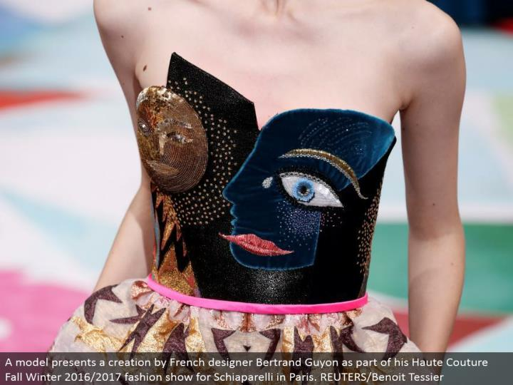 A model displays a creation by French fashioner Bertrand Guyon as a major aspect of his Haute Couture Fall Winter 2016/2017 style show for Schiaparelli in Paris. REUTERS/Benoit Tessier