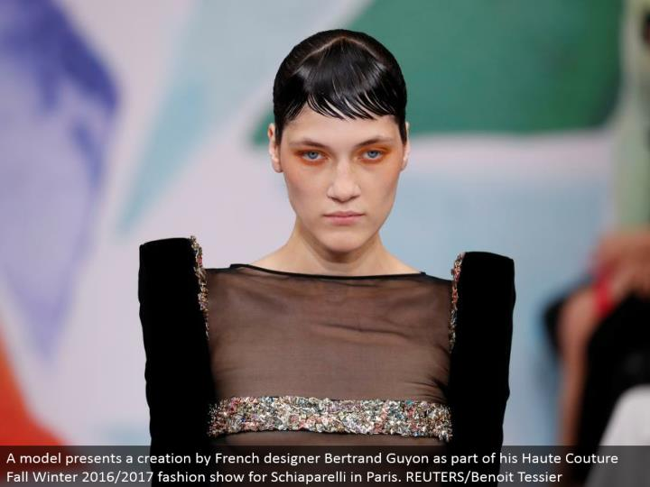 A model displays a creation by French creator Bertrand Guyon as a feature of his Haute Couture Fall Winter 2016/2017 style show for Schiaparelli in Paris. REUTERS/Benoit Tessier