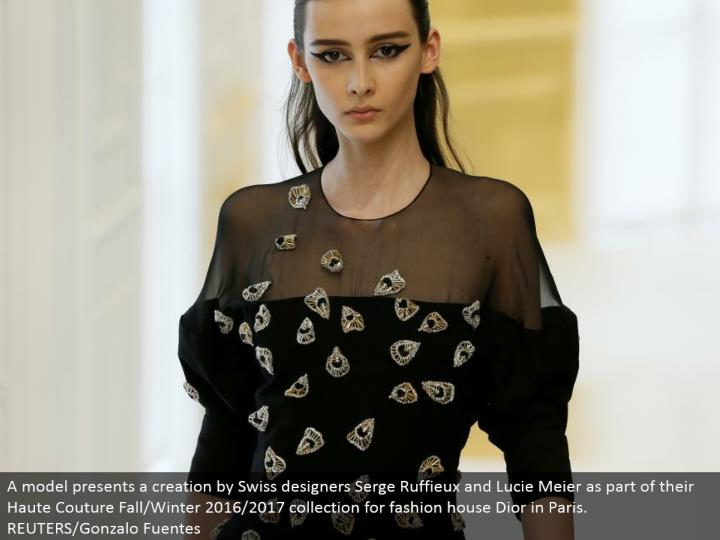 A model exhibits a creation by Swiss planners Serge Ruffieux and Lucie Meier as a feature of their Haute Couture Fall/Winter 2016/2017 gathering for design house Dior in Paris. REUTERS/Gonzalo Fuentes