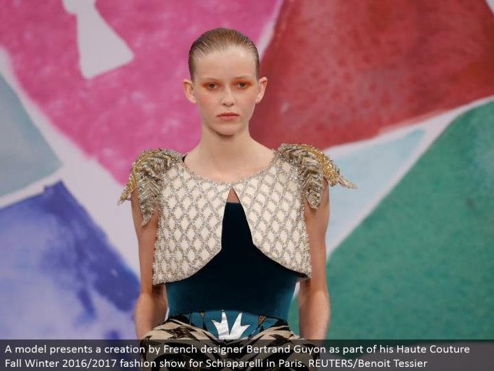 A model displays a creation by French planner Bertrand Guyon as a major aspect of his Haute Couture Fall Winter 2016/2017 style show for Schiaparelli in Paris. REUTERS/Benoit Tessier