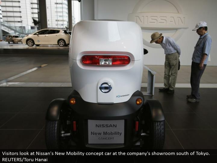 Visitors take a gander at Nissan's New Mobility idea auto at the organization's showroom south of Tokyo. REUTERS/Toru Hanai