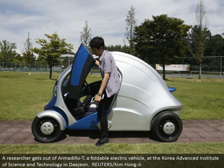 A analyst escapes Armadillo-T, a foldable electric vehicle, at the Korea Advanced Institute of Science and Technology in Daejeon. REUTERS/Kim Hong-Ji