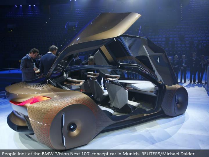 People take a gander at the BMW 'Vision Next 100' idea auto in Munich. REUTERS/Michael Dalder