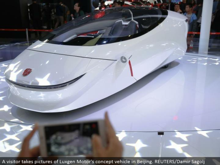A guest takes pictures of Luxgen Motor's idea vehicle in Beijing. REUTERS/Damir Sagolj