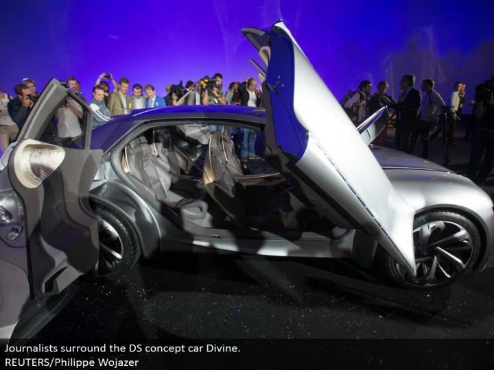 Journalists encompass the DS idea auto Divine. REUTERS/Philippe Wojazer