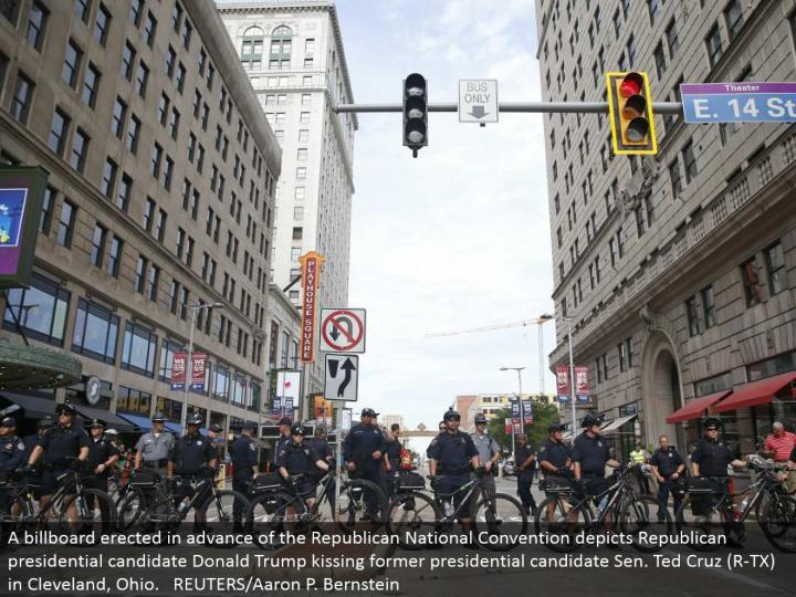 """Police obstruct a downtown road with their bikes amid a walk by different gatherings, including """"Dark Lives Matter"""" and """"Close Down Trump and the RNC"""". REUTERS/Shannon Stapleton"""