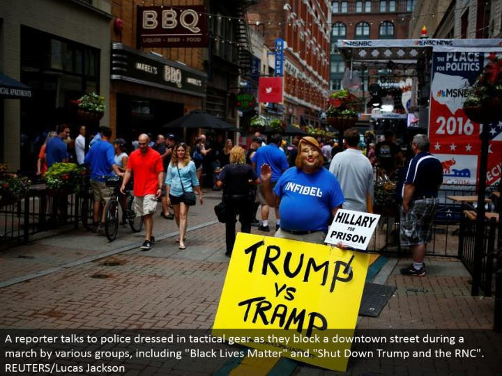 A dissident stands opposite Quicken Loans Arena as setup proceeds ahead of time of the Republican National Convention. REUTERS/Aaron P. Bernstein