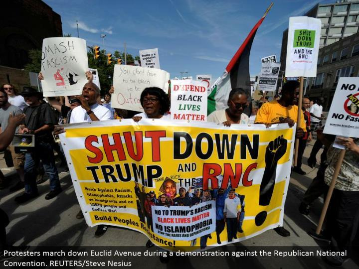 Protesters walk down Euclid Avenue amid a show against the Republican National Convention. REUTERS/Steve Nesius
