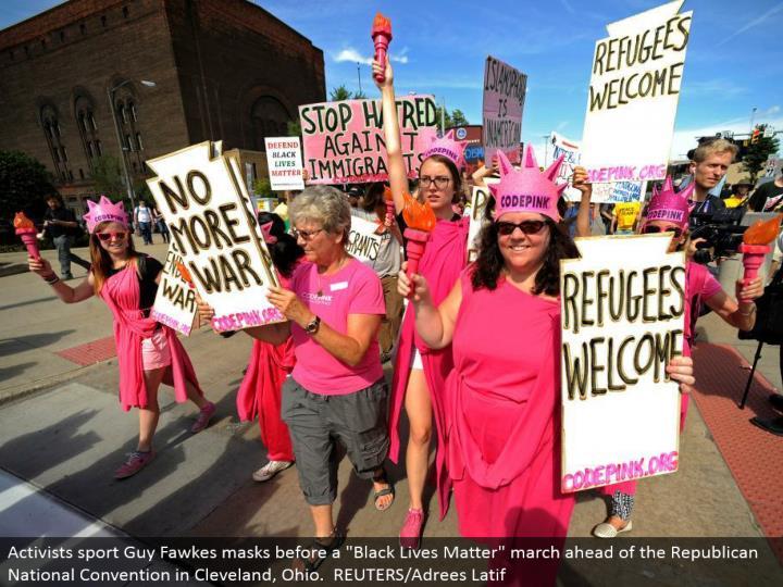 Code Pink activists walk down Euclid Avenue. REUTERS/Steve Nesius.