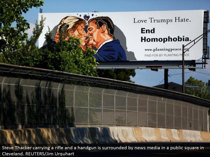 A announcement raised ahead of time of the Republican National Convention delineates Republican presidential competitor Donald Trump kissing previous presidential applicant Sen. Ted Cruz (R-TX) in Cleveland, Ohio. REUTERS/Aaron P. Bernstein