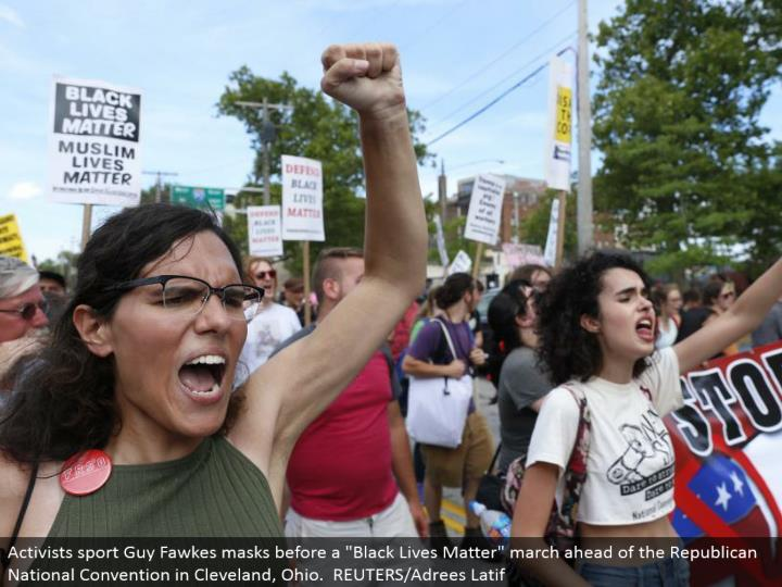 """Demonstrators serenade mottos amid a walk by different gatherings, including """"Dark Lives Matter"""" and """"Close Down Trump and the RNC"""". REUTERS/Lucas Jackson"""