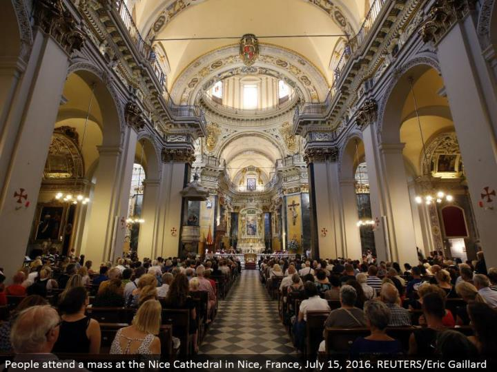 People go to a mass at the Nice Cathedral in Nice, France, July 15, 2016. REUTERS/Eric Gaillard