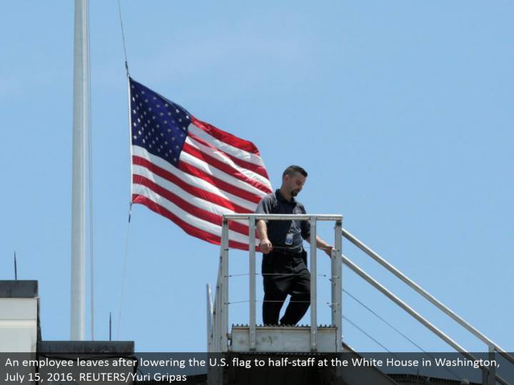 An worker leaves subsequent to bringing down the U.S. banner to half-staff at the White House in Washington, July 15, 2016. REUTERS/Yuri Gripas
