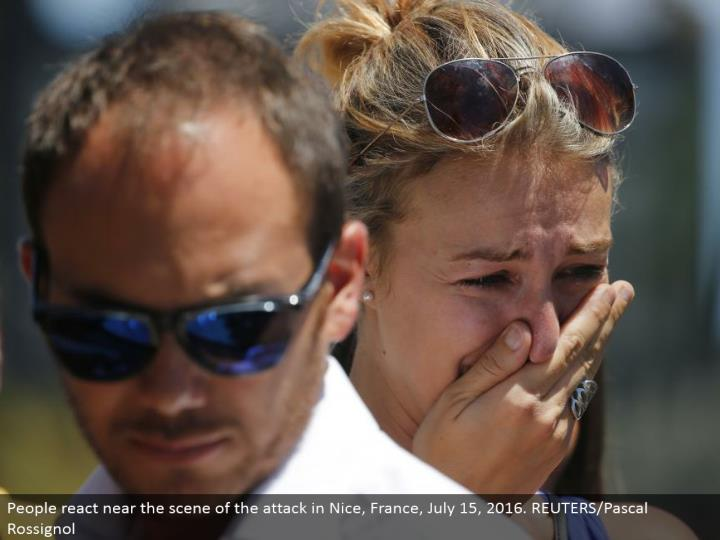 People respond close to the scene of the assault in Nice, France, July 15, 2016. REUTERS/Pascal Rossignol