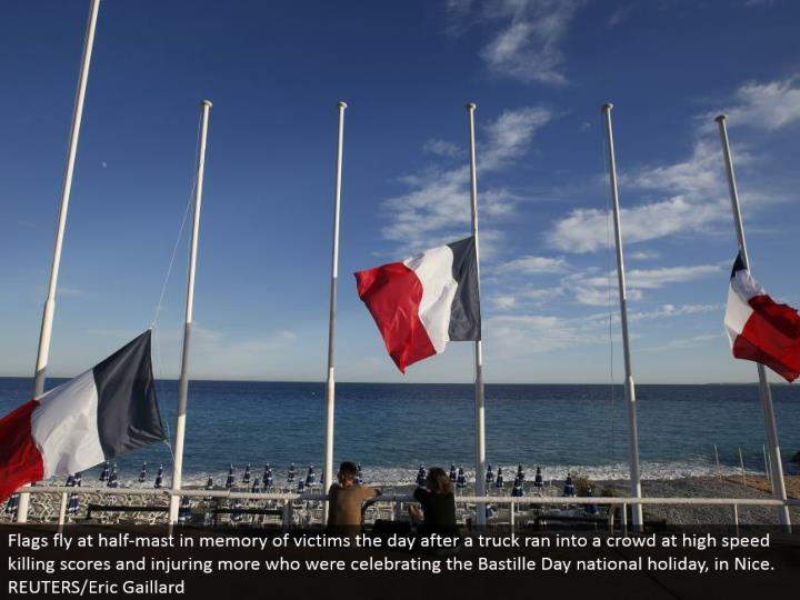 Flags fly at half-pole in memory of casualties the day after a truck kept running into a group at ra...