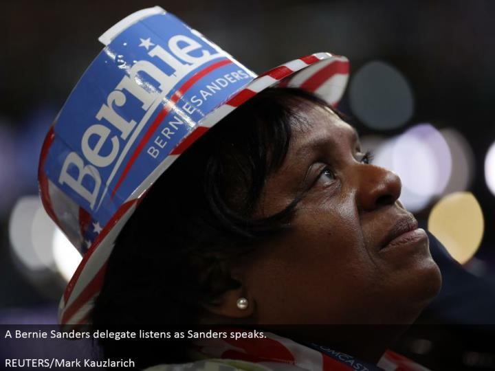 A Bernie Sanders delegate listens as Sanders talks.  REUTERS/Mark Kauzlarich