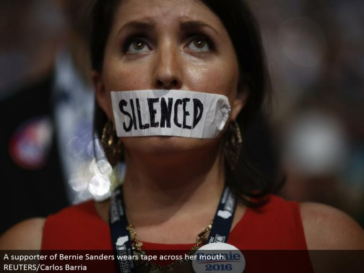 A supporter of Bernie Sanders wears tape over her mouth. REUTERS/Carlos Barria