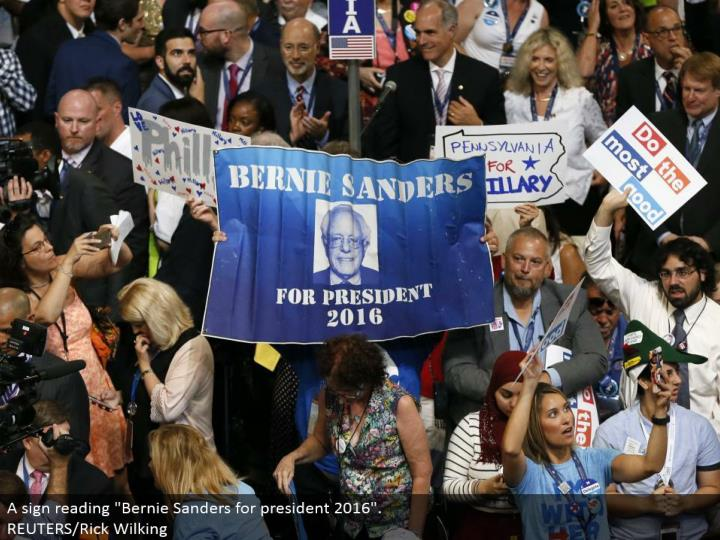 "A sign perusing ""Bernie Sanders for president 2016"". REUTERS/Rick Wilking"