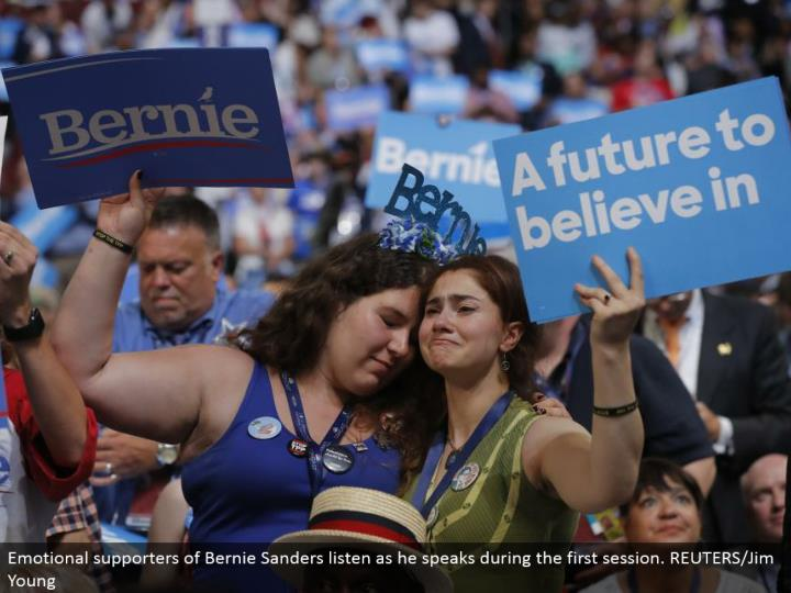 Emotional supporters of Bernie Sanders listen as he talks amid the principal session. REUTERS/Jim Young