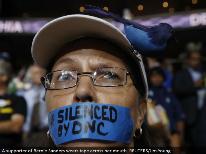 A supporter of Bernie Sanders wears tape over her mouth. REUTERS/Jim Young