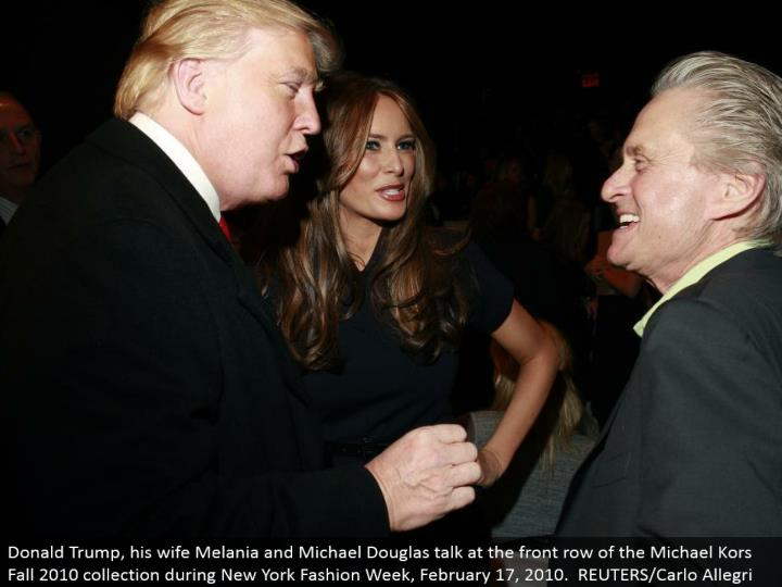 Donald Trump, his better half Melania and Michael Douglas talk at the front line of the Michael Kors Fall 2010 accumulation amid New York Fashion Week, February 17, 2010. REUTERS/Carlo Allegri