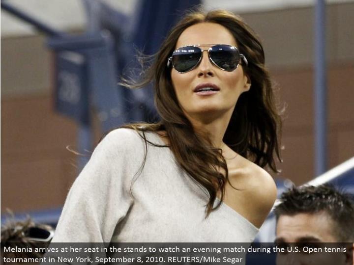 Melania touches base at her seat in the stands to watch a night match amid the U.S. Open tennis competition in New York, September 8, 2010. REUTERS/Mike Segar