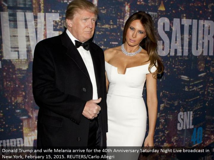 Donald Trump and spouse Melania land for the 40th Anniversary Saturday Night Live telecast in New York, February 15, 2015. REUTERS/Carlo Allegri