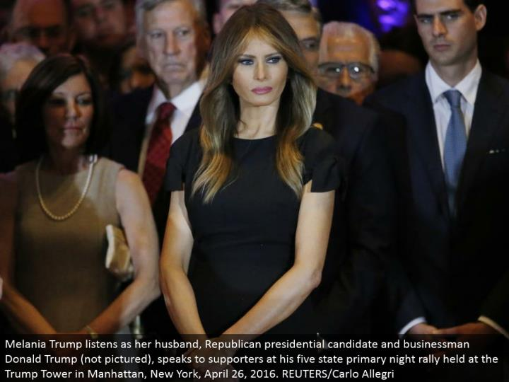 Melania Trump listens as her significant other, Republican presidential hopeful and representative Donald Trump (not envisioned), addresses supporters at his five state essential night rally held at the Trump Tower in Manhattan, New York, April 26, 2016. REUTERS/Carlo Allegri