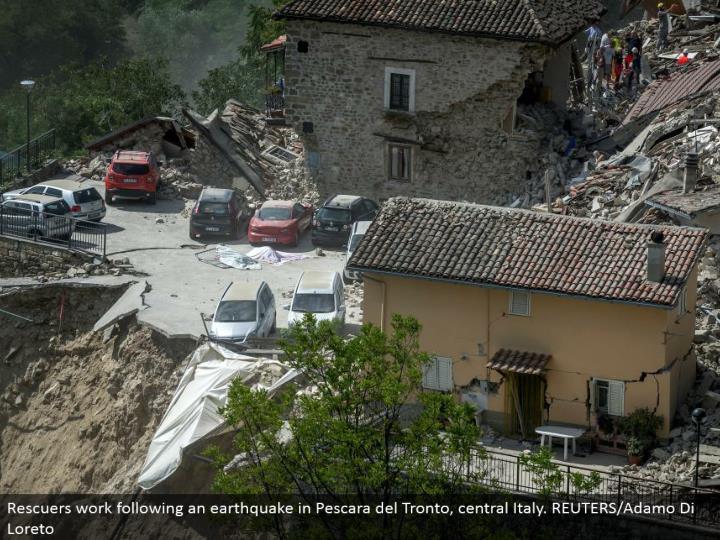 Rescuers work taking after a shake in Pescara del Tronto, central Italy. REUTERS/Adamo Di Loreto