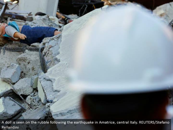 A doll is seen on the rubble taking after the seismic tremor in Amatrice, central Italy. REUTERS/Stefano Rellandini