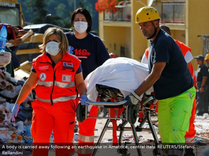 A body is redirected after a shake in Amatrice, central Italy. REUTERS/Stefano Rellandini