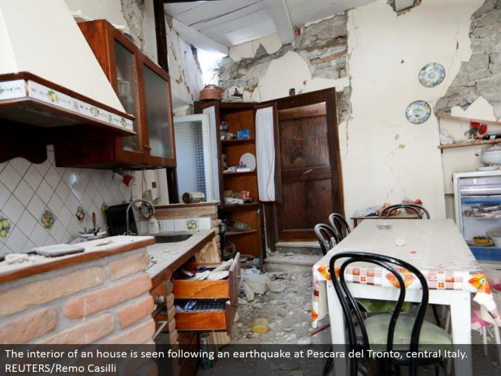 The within a house is seen taking after a seismic tremor at Pescara del Tronto, central Italy. REUTERS/Remo Casilli