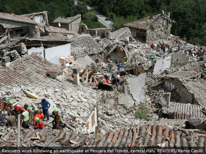 Rescuers work taking after a seismic tremor at Pescara del Tronto, central Italy. REUTERS/Remo Casilli