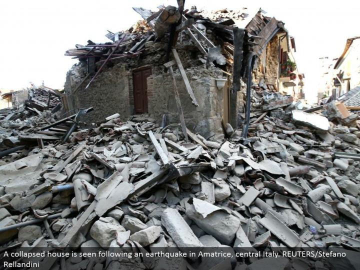 A separated house is seen taking after a tremor in Amatrice, central Italy. REUTERS/Stefano Rellandini