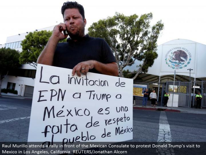 Raul Murillo goes to a rally before the Mexican Consulate to challenge Donald Trump's visit to Mexico in Los Angeles, California. REUTERS/Jonathan Alcorn