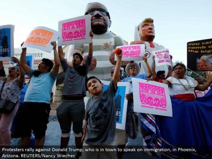 Protesters rally against Donald Trump, who is around the local area to talk on movement, in Phoenix, Arizona. REUTERS/Nancy Wiechec