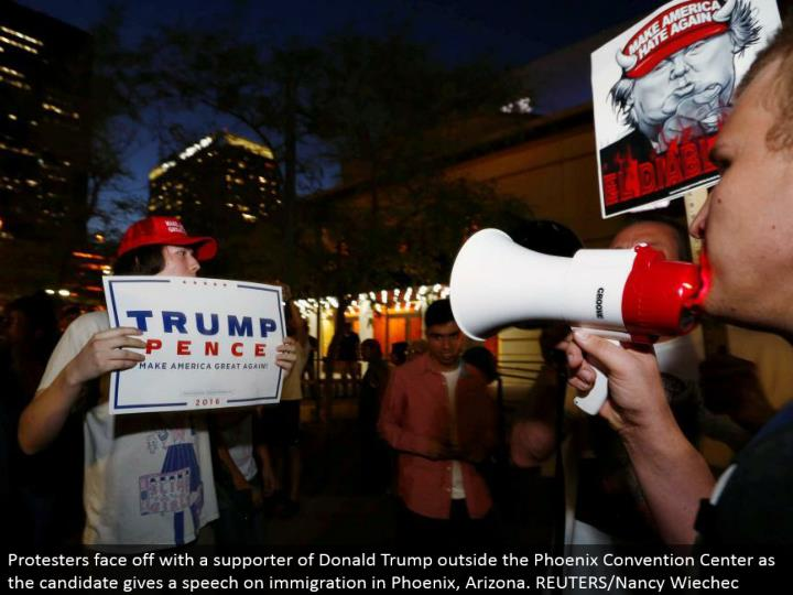 Protesters go head to head with a supporter of Donald Trump outside the Phoenix Convention Center as the competitor gives a discourse on migration in Phoenix, Arizona. REUTERS/Nancy Wiechec