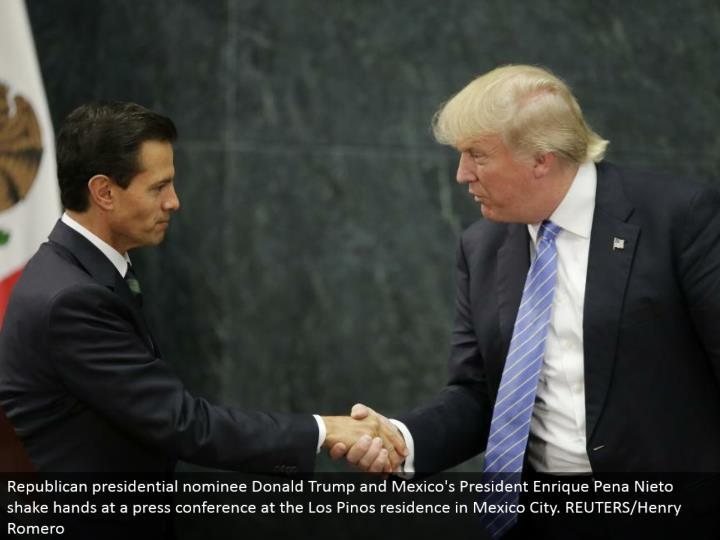 Republican presidential chosen one Donald Trump and Mexico's President Enrique Pena Nieto shake hand...