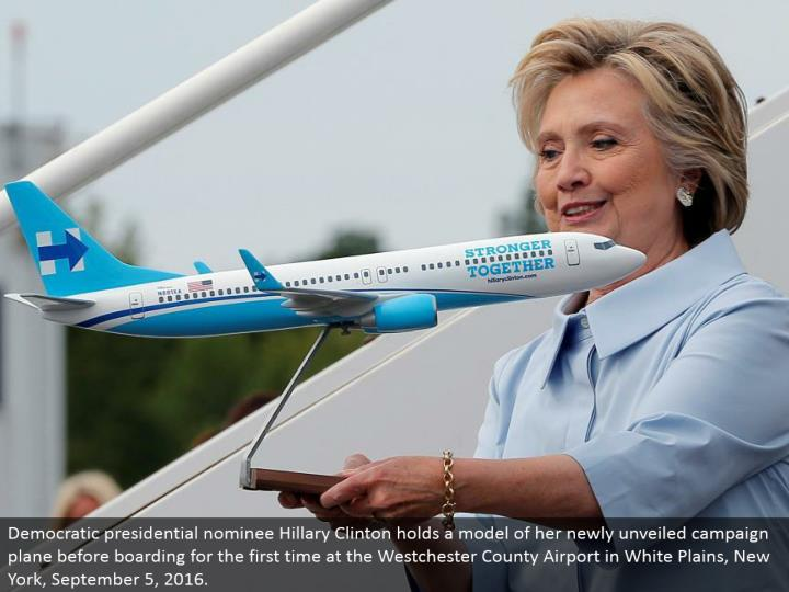 Democratic presidential chosen one Hillary Clinton holds a model of her recently divulged battle plane before loading up surprisingly at the Westchester County Airport in White Plains, New York, September 5, 2016.