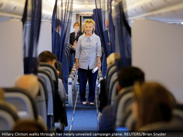 Hillary Clinton strolls through her recently revealed crusade plane. REUTERS/Brian Snyder