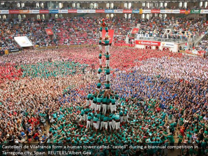 "Castellers de Vilafranca structure a human tower called ""castell"" amid a half-yearly rivalry in Tarragona city, Spain. REUTERS/Albert Gea"