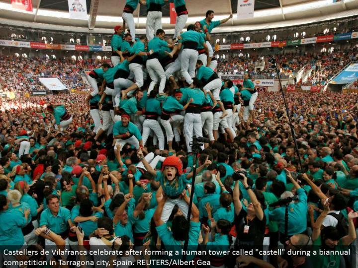 "Castellers de Vilafranca celebrate subsequent to shaping a human tower called ""castell"" amid a half-yearly rivalry in Tarragona city, Spain. REUTERS/Albert Gea"