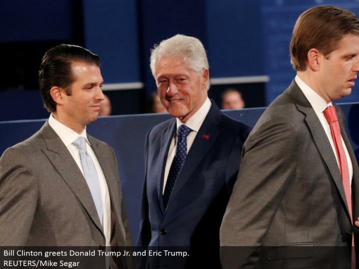 Bill Clinton welcomes Donald Trump Jr. what's more, Eric Trump.  REUTERS/Mike Segar