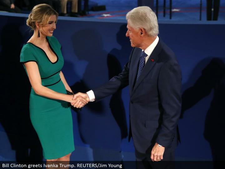 Bill Clinton welcomes Ivanka Trump. REUTERS/Jim Young