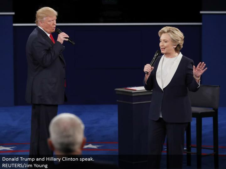 Donald Trump and Hillary Clinton talk.  REUTERS/Jim Young