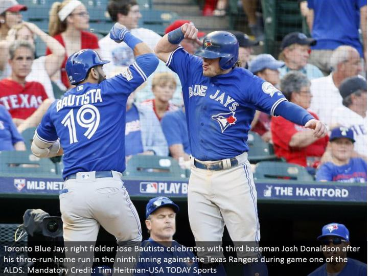 Toronto Blue Jays right defender Jose Bautista celebrates with third baseman Josh Donaldson after his three-run grand slam in the ninth inning against the Texas Rangers amid amusement one of the ALDS. Obligatory Credit: Tim Heitman-USA TODAY Sports
